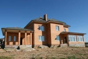 Кирпичный дом, облицован лицевым кирпичом